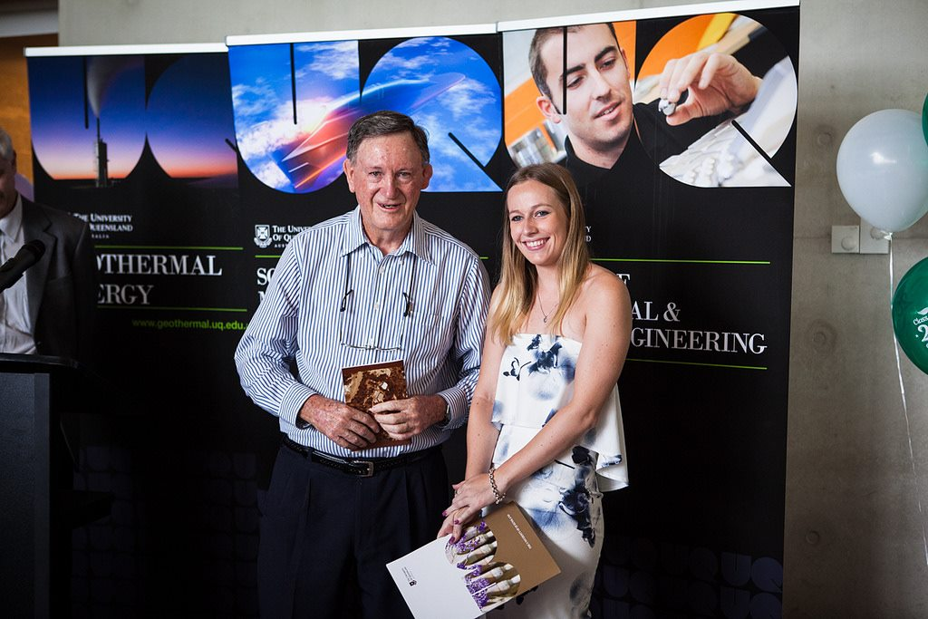 Kimberley Maher receiving Logan Prize for best underground metalliferous thesis from prize sponsor Sam Logan (Permission from UQ SOMMM)